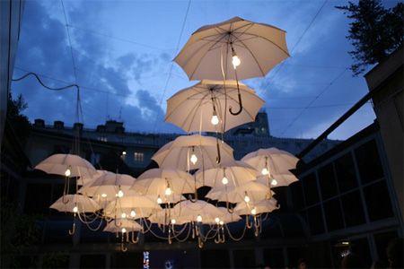 "Art Installation of ""lit"" umbrellas at the entrance to design week in Milan - Cumulous Light Canopy by Steven Haulenbeek."
