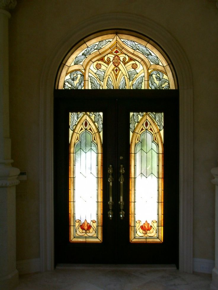 Stained Glass Entry Doors and Transom in a Moorish Style for This Custom Home in a Gated Community