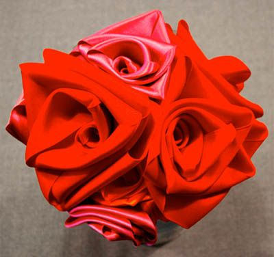 DIY ribbon roses and 10 other DIY fabric flowers. Add a pretty accent to a head band, belt, gift, or for stand alone use. skiptomylou.org #fabricflowers #flowers #diyflowers