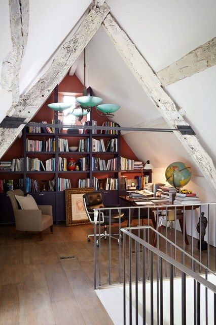 Bookshelf built into the eaves/attic library