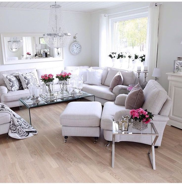 Beautifully designed. The use of neutral furniture and walls allows you to change your look with pops of colors, pillows changes, use of rugs, flowers, candles, sectional allows for different placement and looks and well put together vingettes