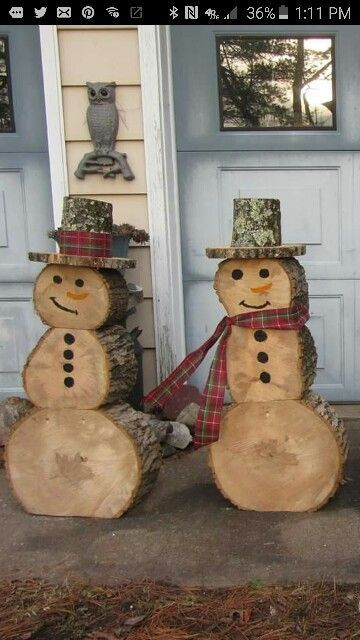 what-a-great-idea-snowmen-made-out-of-recycled-logs-out-of-the-yard
