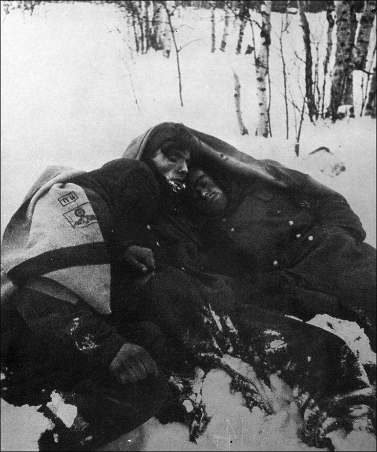 German prisoners of war sleep in a deep snow bank during the Battle of Moscow (Winter 1941).