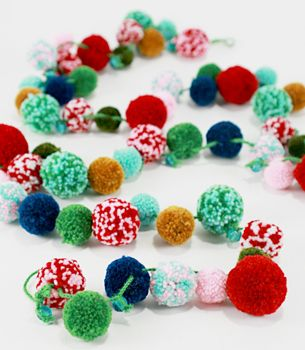 DIY Pom Pom Holiday Garland from Fred Flare