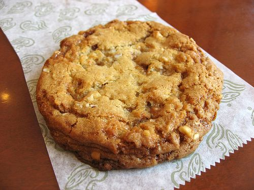 "Panera Bread Toffee Nut Cookie."" A rich, all butter cookie with pieces of English toffee and chunks of Brazil nuts."""
