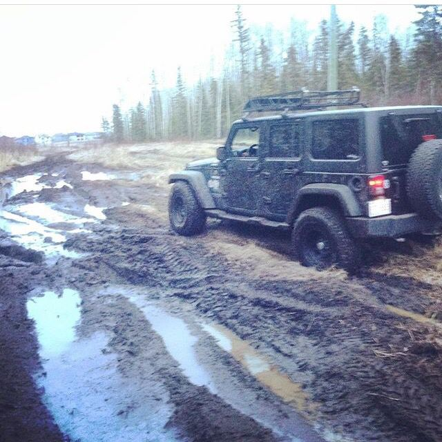 Off-roading on a pole line in Fort McMurray Alberta having some fun in the mud.