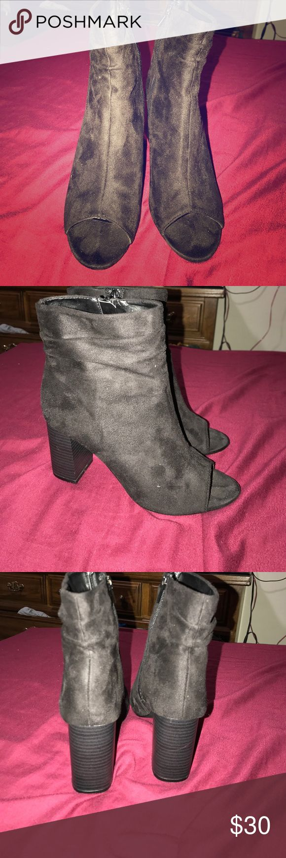 Charlotte rouse Black suade booties Charlotte rouse Black suade booties. Never been worn and in great condition. They're open toes and have zipper on the side. OPEN TO OFFERS BUT NO TRADES Charlotte Russe Shoes Ankle Boots & Booties