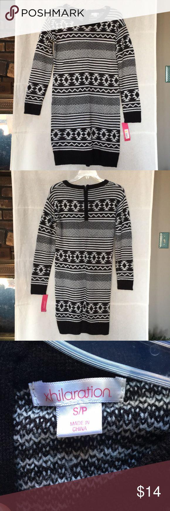NWT Xhiliration black & white tribal sweater dress NWT xhiliration black and white tribal design sweater dress. Zips at back of neck. Xhilaration Dresses