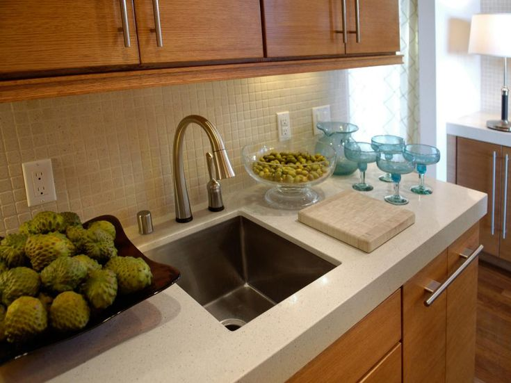 A Delta Pilar® faucet with Touch20 Technology aids the hostess. The faucet turns on and off with a gentle tap. An Oliveri sink is outfitted with a garbage disposal.