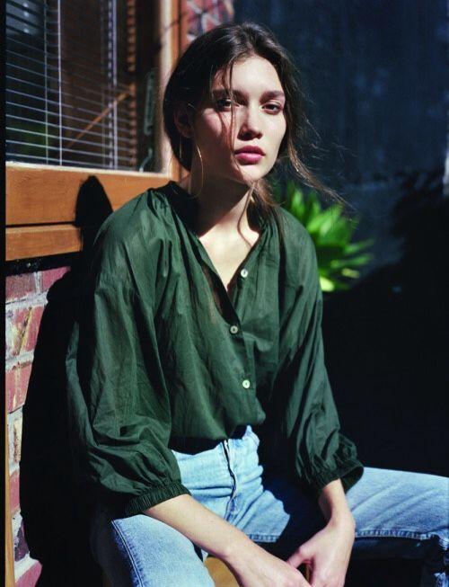 Green shirt, jeans.