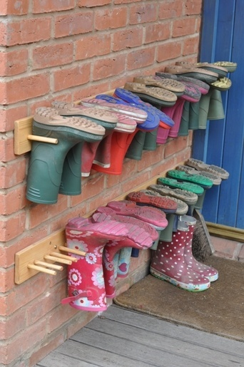 because our mud room sees a lot  of muddy, sticker coated wellies and an upside down wellie harbors no mice (yuck)