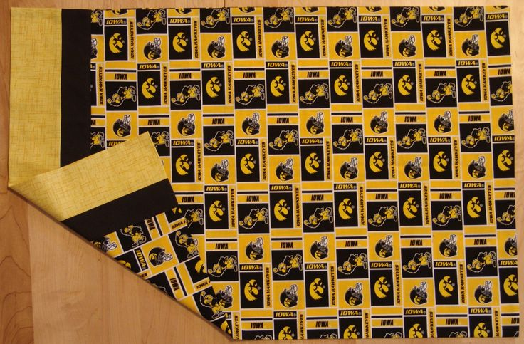 Iowa Hawkeye Football Pillowcase.  Longer than standard pillowcasee made with Iowa Hawkeye fabric and trimmed with black & gold at opening by EmilHansDesigns on Etsy