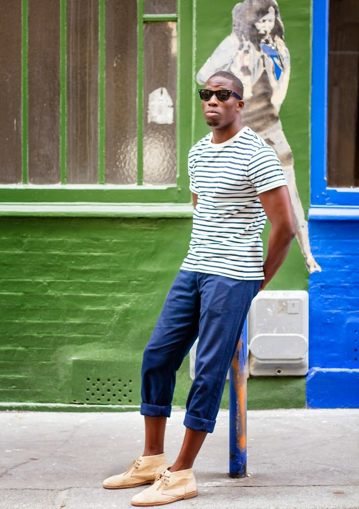 Shop this look on Lookastic:  http://lookastic.com/men/looks/black-sunglasses-white-and-navy-crew-neck-t-shirt-blue-chinos-tan-desert-boots/6573  — Black Sunglasses  — White and Navy Horizontal Striped Crew-neck T-shirt  — Blue Chinos  — Tan Suede Desert Boots