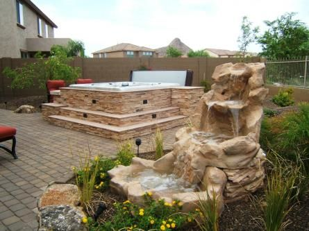 Love faux stone around a hot tub and steps so easy with for Above ground pool siding ideas