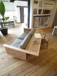 I like the idea.....built-in sofa table or workspace