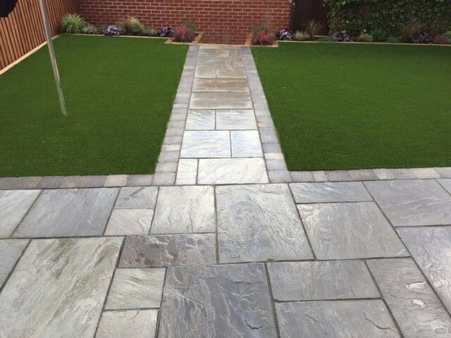 Marshalls Natural Stone Indian sandstone with Tobermore tegula block paving boarder and Namgrass Elise artificial grass. A great family garden with very little maintenance.