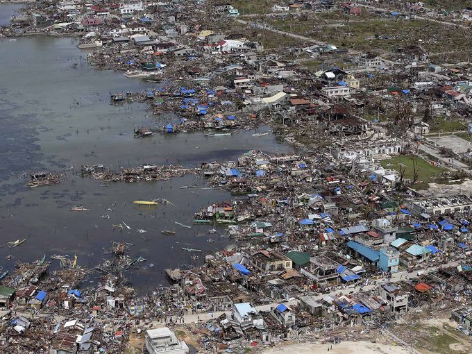 The aftermath of Typhoon Haiyan in Guiuan, Samar province, Philippines, on Nov. 11, 2013 :: via USA Today with information on How You Can Help