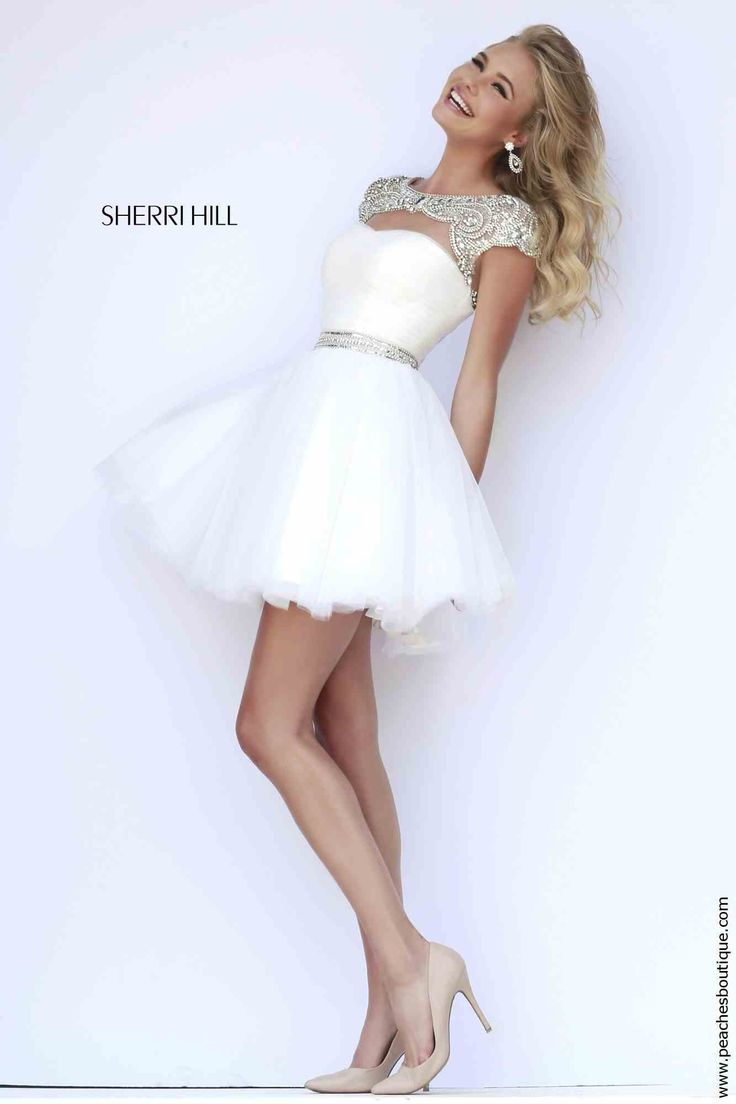 Sherri Hill 11191 Short Beaded Graduation Dress, colour: Ivory/Silver for $448 (originally $598) from Peaches Boutique. Only sizes 16 and 18 are available. Final sales - no returns or exchanges.