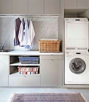 dream laundry. so much storage, and even a hanging space. dislike: perhaps too grey all over.