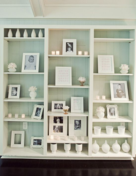 peed my pants in joy on this one a little bit- lets do this on the book cases that are next to the fireplace!!! start finding baby photos of the two of you. I'll make an IKEA run to get white vases and stuff :)