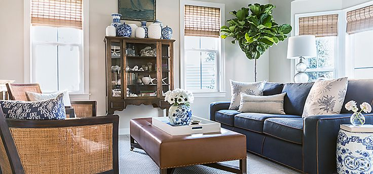 """While the pieces here look polished, they're also highly   practical: A leather ottoman holds up beautifully to shoes and   sandy feet, and the dark sofa hides movie-night popcorn spills.   The cane chairs are upholstered with an outdoor fabric, one of   Matthew's go-tos. """"Especially at the beach, I want people to feel  like they can sit down and not worry about messing something up."""""""