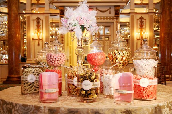 Candy buffet of ivory, gold, and pink candies