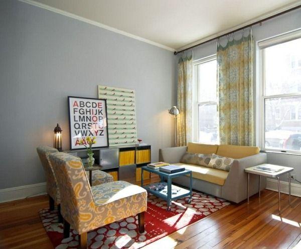 gray wall armchair in brown Roman blind