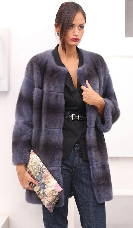 Female Mink Fur Coat with whole skins. Made in Italy. Skins Quality: Kopenhagen Fur Platinum; Color: Blue Denim; Closure: With hooks; Collar: Plat; Lining: 100% Satin; Lining Color: Fantasy, Multicolor; Length: 83 cm;