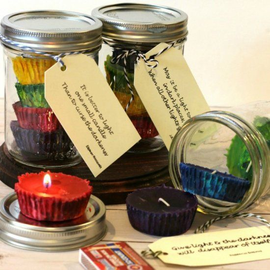 We used old crayons to make colorful cupcake candles and packed them up for an awesome inexpensive gift idea.
