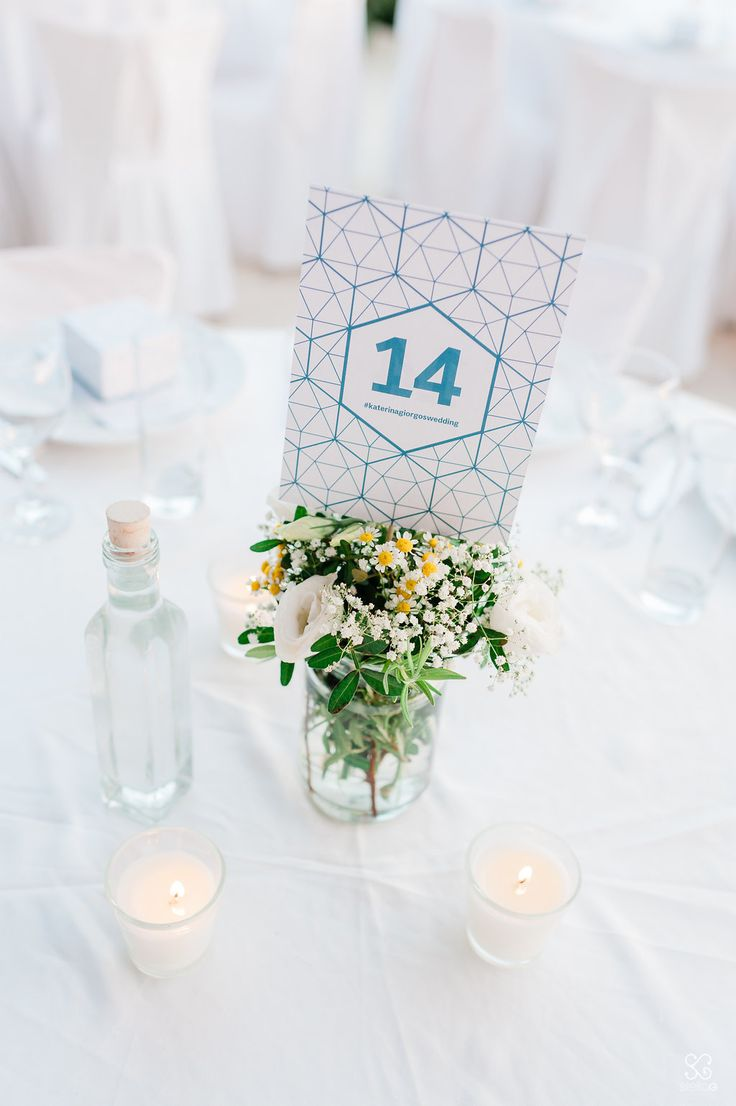 Tailor made table numbers!  #tablenumbers #blueandwhite #flowers #jar #centerpieces #weddingplanner #decoration #dreamsinstyle