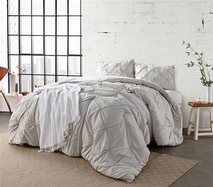Shop at DormCo for our Silver Birch Pin Tuck Twin XL Comforter. This dorm item has a soft, neutral color with textured details to allow versatility in your dorm room decorating theme and has a thick inner fill with softer than cotton fabric for comfort.