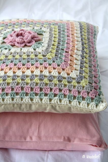 Lovely idea: a flower-centered granny square that just keeps on going until it's cushion sized