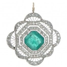 A 14ct white gold topped yellow gold pendant featuring a square emerald cut emerald of estimated weight 3.50ct set in a fine millegrain edged bezel within a spaced double cluster of old single cut diamonds. View our latest catalogue at www.rutherford.com.au
