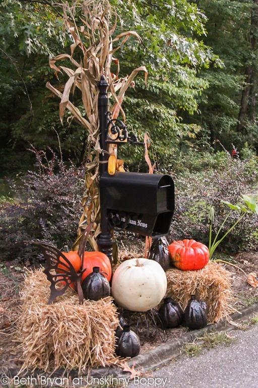 Fall mailbox decor-pumpkins, hay and rusted metal