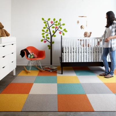 FLOR rug for playroom. Can replace each carpet square individually if necessary.