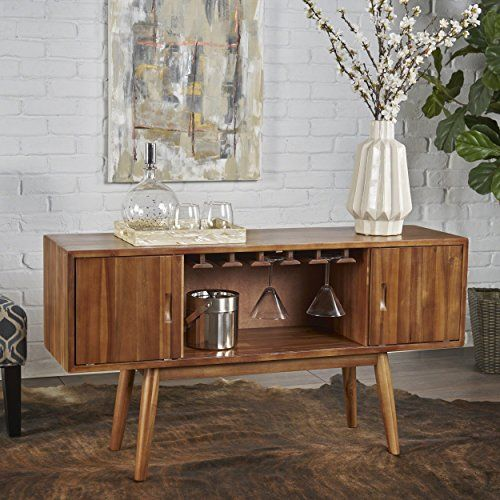 Mid Century Modern Light Oak Wood Wine Cabinet Update your bar, kitchen or dining room with this chic Mid Century Modern Light Oak Bar Cabinet. This stunning piece will bring sophistication and style to any room and artfully display your coveted wine collection. Made from sturdy acacia wood with enough shelves to store eighteen bottles, […]