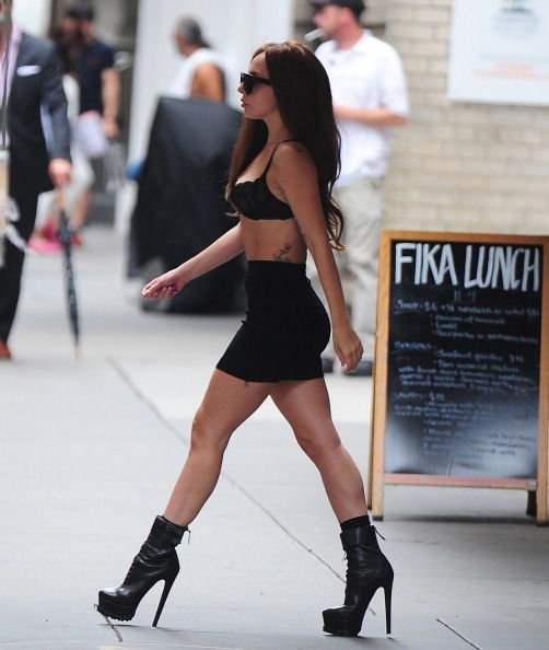 Lady Gaga Wears a Bra, Not Much Else, to Walk Around Midtown Manhattan....looks like gaga wants to just show people she is skinny again.. (if they knew it was her).   she is a great artist But we wonder what our celebs are thinking these days..