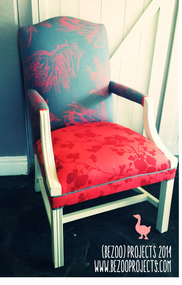 Vintage armchair: painted white with denim and coral upholstery.