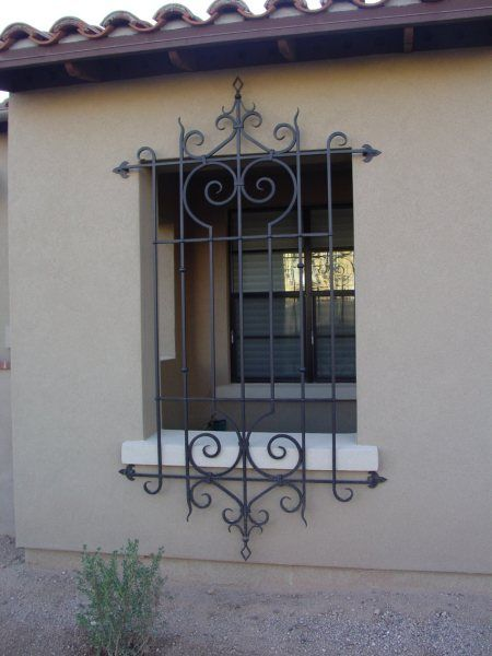 WROUGHT IRON WINDOW GRILLS. open the windows for all day air circulation