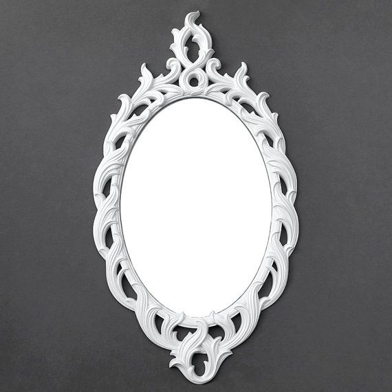 Gorgeous ornate vintage Turner mirror painted in satin white. This is a great standout piece for your living or dining room and adds instant
