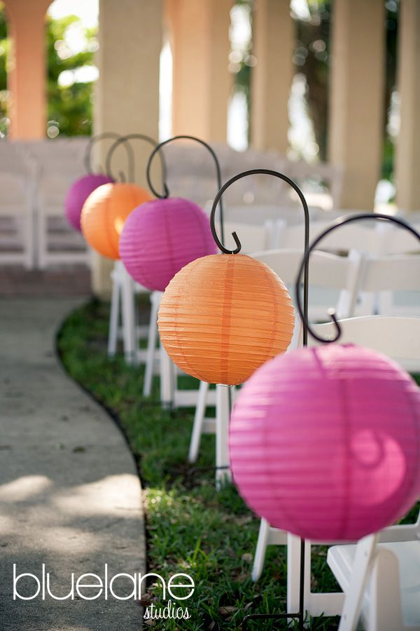 orange and fuchsia paper lanterns on shepherd hooks. You can easily copy this look using our paper lanterns. As low as $0.85