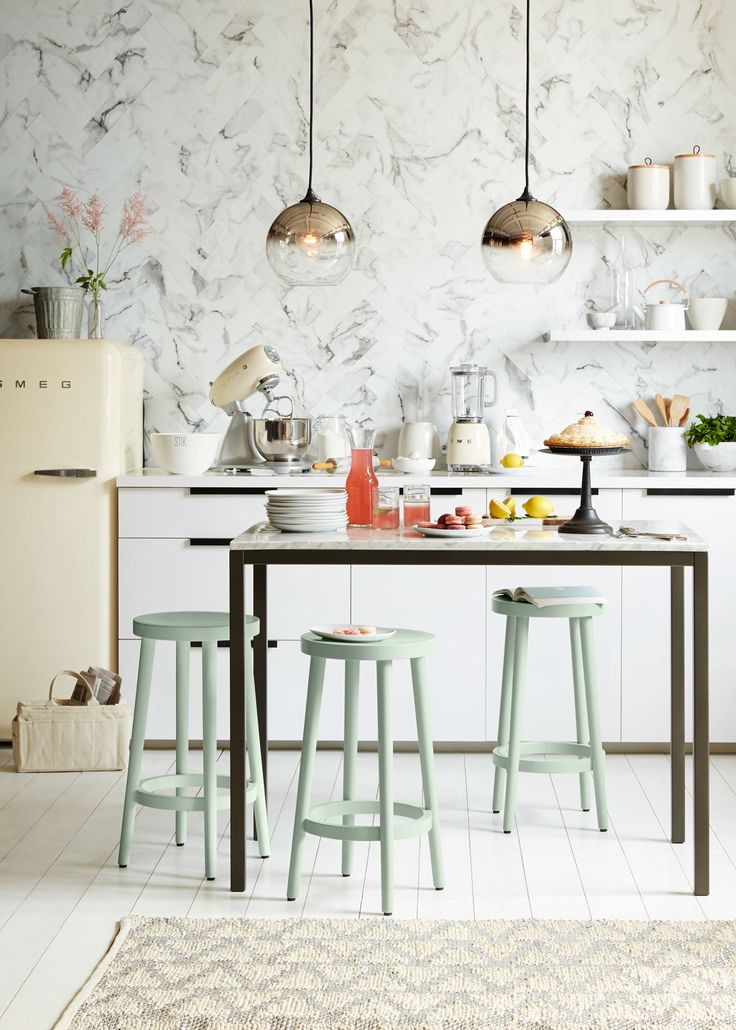 Two Ombre Mirrored Pendant lights from west elm add striking style to this beautiful kitchen. Browse all our pendant options at westelm.com