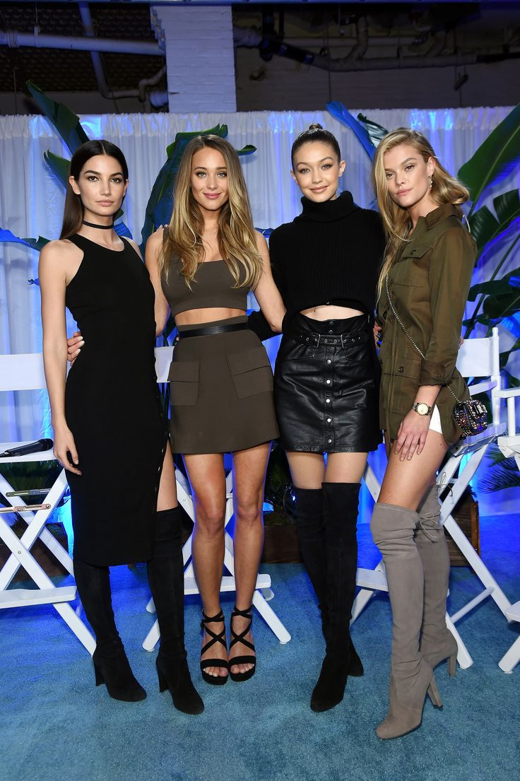 Gigi took a break from the runway to hang out with the supermodels at the Sports Illustrated Swim City even...