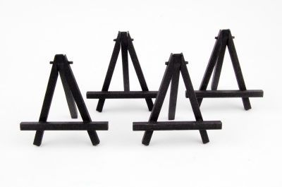 Mini Easels can be found at Michaels in a 4-Pack to be accompanied with mini canvas'