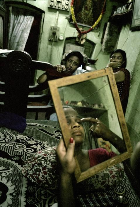 Alex Majoli. INDIA. West Bengal region. Calcutta. In a brothel inside Bahu Bazar red light area. June 2002