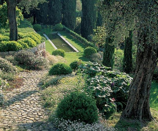 "Marta and Gerard Lamy, along with landscape architect Jean Mus, laid out an old-fashioned garden at their mas in Grasse, France. ""The garden is like a balcony overlooking the Côte D'Azur and the Mediterranean,"" says Lamy. (Architectural Digest October 1999)"
