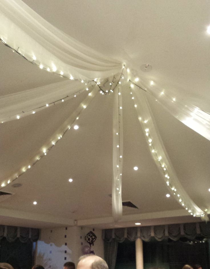 Fairy lights on the ceiling. They actually come with the room, but I thought they were the finishing touch.