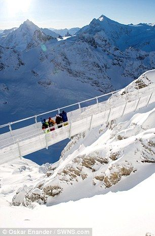 Don't look down! World's 'scariest' and highest suspension bridge at 1,500ft above a glacier in the Swiss Alps