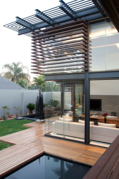 excellent detailing of deck, pool, glass wall and cantilever roof line