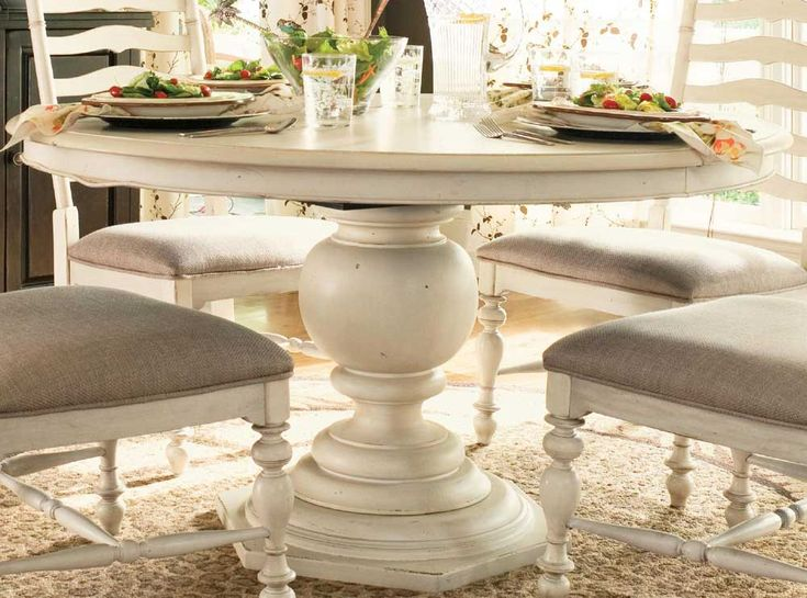 Really love this Paula Deen Linen Round Pedestal Table (UF-996655).  I especially like how there are no claw feet interfering with chair placement.